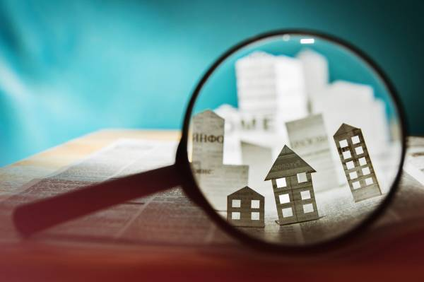 magnifying glass on pop up buildings