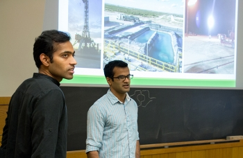 Tuck students offer a lecture on drilling practices to their fellow classmates.