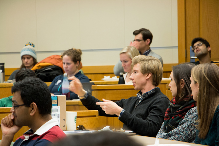 Tuck students hear a lecture offered by classmates in the energy industry