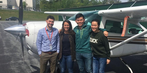 Tuck students on a flight with Tuck veteran pilot