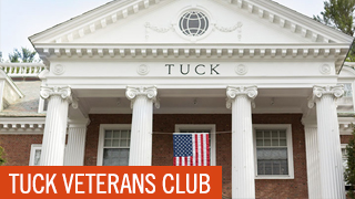 Tuck Veterans Club - Tuck Hall with American Flag